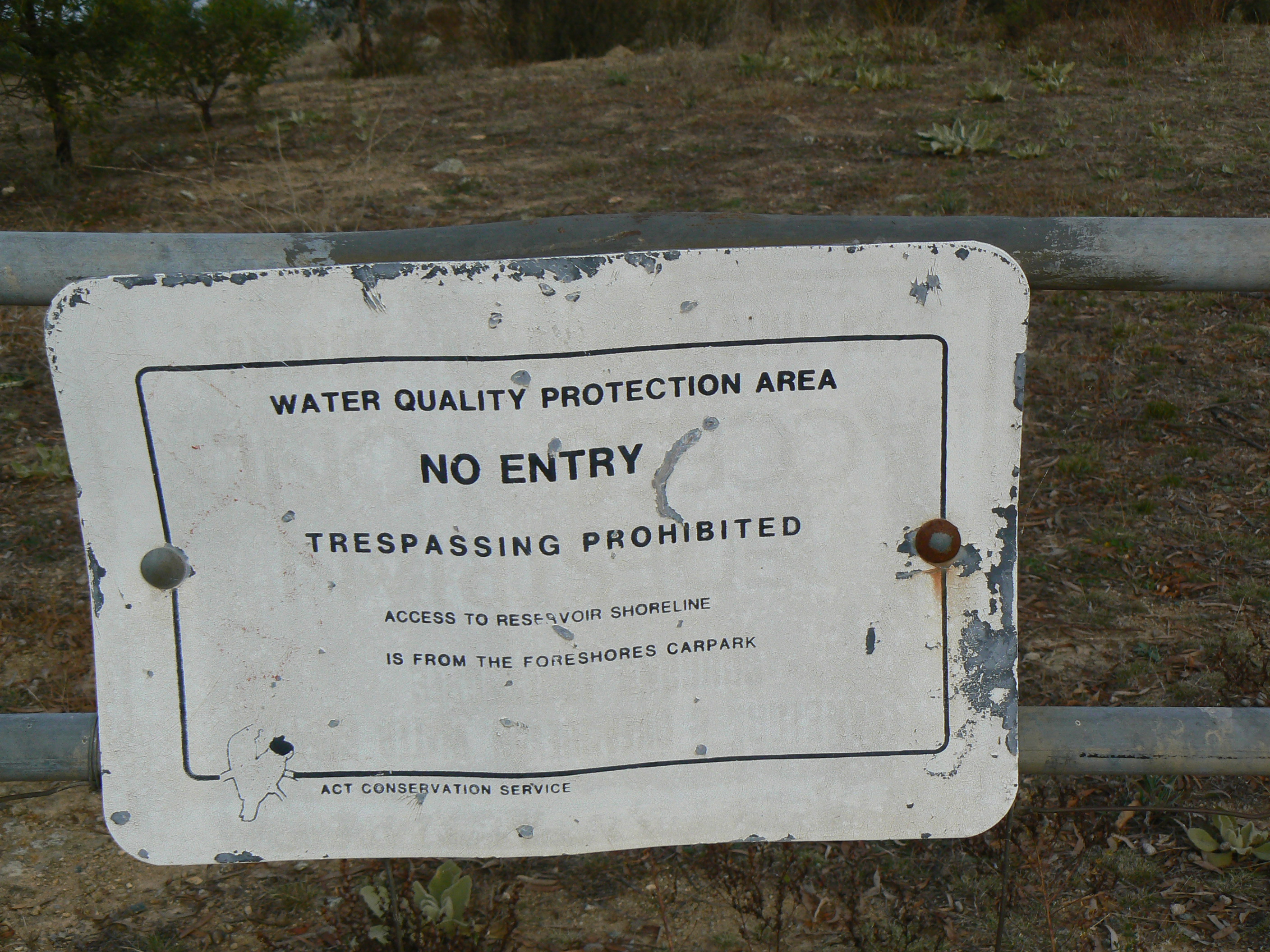"An older ""no entry"" sign. Funny that it's from the ACT Conservation Service considering that the Dam is in New South Wales, and has only recently come under ACT Government control."