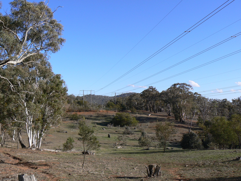 The powerlines cross the path and continue on around the back of Hackett and Ainslie, where they eventually reach the Mount Ainslie Substation