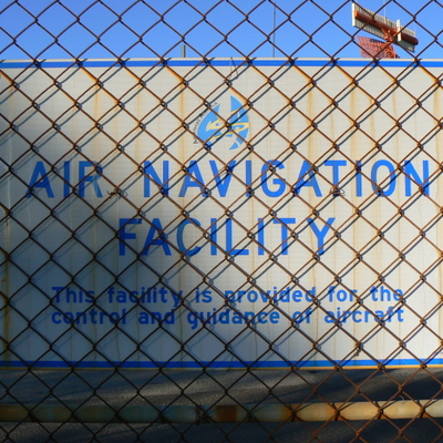 Sign on the fence of the Mount Majura Radar Complex. This sign has the Airservices Australia logo on it.