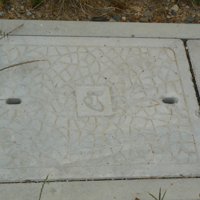 A Telstra pit cover.