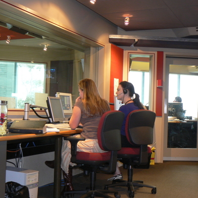 Executive Producer Kate with Producer Ally, and in the background Technical Producer Dave